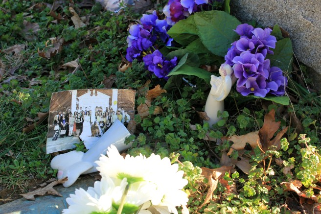 Someone left some fake violets and daisies, two porcelain angels, and a photo. I'm pretty sure it's from the church who provided them a home in their old age.